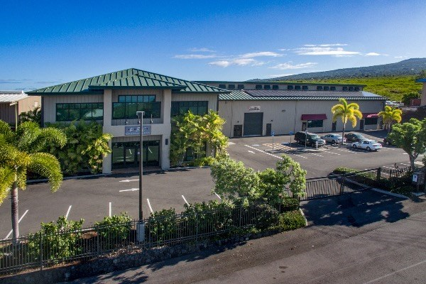 Premiere  Warehouse / Office building in Kohanaiki Business Park on once acre of land. High-end improvements with elements of Hawaiian design developed by Tinguely Development, a prominent West Hawaii real estate developer. Located minutes from Kona International Airport, with easy access to Kohala Coast Resorts and Kailua Kona town center.  The information herein may contain inaccuracies and is provided without warranty or guaranty of any kind. Agents and Buyers must independently verify any information they deem material or important to their purchase or any offered price there under. Please refer to the Title Report for easements and setbacks.