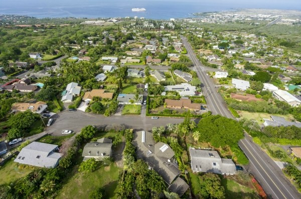 Private, large lot, located on a cul-de sac. Room for swimming pool or addition. Kailua View Estates is centrally located in the heart of Kailua-Kona, close to shopping parks and beaches. Open floor plan with large living area and vaulted ceilings. 3 bedroom/2.5 bath with additional den/office. Permitted Den/office was expanded to add additional area.(Completed As-Built Permit)Two bedrooms are over sized. Perfect family home! Two-story home offers all the interior square footage needed with a minimal footprint on the lot, allowing for more usage of the land. Great Neighborhood! Great Location!!!