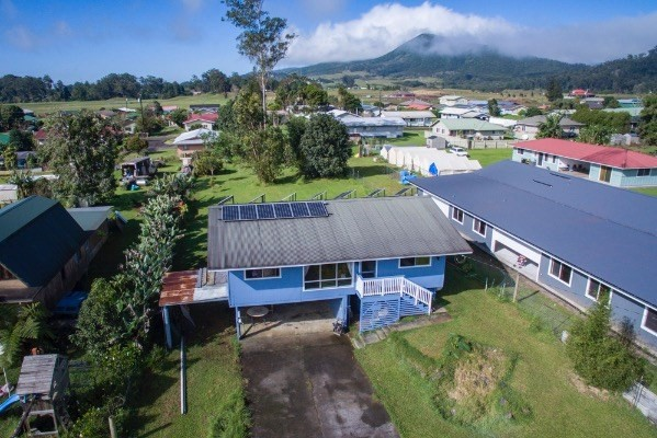 Located under 10 min from Waimea town & hospital, Pleasant Acres is an established neighborhood surrounded by larger lots.  This well maintained home is the perfect cozy hideaway with everything you need. Large lot offers room to build, garden or just relax by the fireplace. Under the home, duel carport with additional hobby and storage areas. Some highlight features include;  18 panel PV system with Envision wireless monitoring (This system is paid for & not leased.) Electric fireplace GE Profile appliances-washer, dryer & refrigerator Gas stove/oven and dryer with large propane storage tank Property fully fenced Mighty Mule electric gate with solar charging and remote access Landscaping includes Orchid Planter boxes, Koa  and Ohia trees with native Hibiscus Electric car charging system installed 168 sq ft back lanai overlooking large back yard  Information herein while deemed reliable may contain inaccuracies and is provided without warranty or guarantee of any kind. Agents and buyers are advised to engage qualified specialists to verify any information they deem material or important to the decision to purchase the property including, but not limited to, the condition, permits and square footage of the property.