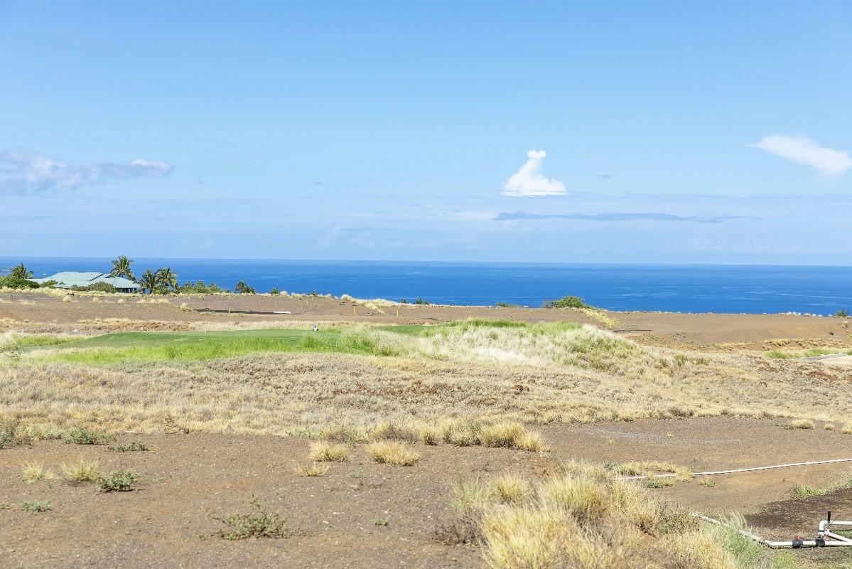"""It is no accident that Rockefeller chose this very place to realize his vision. As he surveyed the length of the coast he selected the two most perfect beaches, but also the land with the most character. He recognized the opportunity to create golf courses with character, and homesites with expansive views and a benign climate that were all unique to what would become Mauna Kea Resort.Indeed, those that know Hawaii, and especially those fortunate to live here full time often favor mauka properties – those on the mountain. Breezes tend to keep the temperatures a bit cooler, but elevation also rewards owners with spectacular views – panoramic 360° vistas from the snow-capped Mauna Kea to Hualalai, and 50-miles of white water shoreline that run the length of the Kohala Coast. In the distance, neighboring Maui and Haleakala.The first release of Hapuna Estates are 11 estate homesites measuring from more than one half to over one acre. They sit privately along the 7th and 8th fairways of Arnold Palmer-designed Hapuna Golf Course. Owners may choose to join the Club at Mauna Kea Resort and enjoy both the Hapuna and Mauna Kea golf courses, along with all the renowned amenities of two of the best luxury hotels on the island. Estate owners can also walk to the Amaui Clubhouse, designed by de Reus Architects, one of Architectural Digest's """"Top 100 Architects and Designers.""""Lot 6 is located on Hapuna Golf Course's 8th fairway and features ocean, golf and majestic mountain views."""