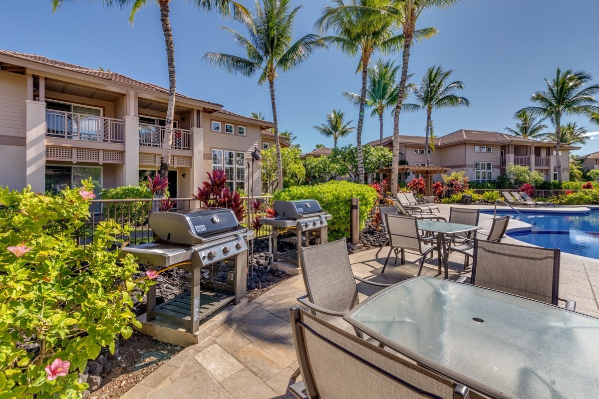SELLER IS TAKING BACK UP OFFERS -  If you are looking for the convenience and relaxation of the Resort Condominium Lifestyle but still want a private oasis feel, then look no further than Waikoloa Colony Villas #2702.  This unit has a unique location with views of lovely sunset colors, garden oases and  stunning Hawaii foliage.  In addition, the owners who are full time residents have upgraded the flooring throughout the dining room, living room and kitchen with Curly Koa laminate, upgraded all the kitchen appliances AND had all the kitchen cabinets re done in white for a light bright feel.   #2702 offers great value and will sell quickly not only because it is the lowest price 3 bedroom condo in the entire Waikoloa Beach Resort,  but also due to its private location, spacious 1699 Sq foot townhome floor plan with no one above or below you, central air, granite countertops, ATTACHED GARAGE  and option for an additional leased space, but also because buyers really appreciate the value they get for their property dollar in this complex with AOAO  fees that include  water, trash pick up, wastewater service, common area maintenance,  basic cable TV, internet AND quarterly pest maintenance inside AND out!  Amenities include 2 GORGEOUS LAGOON STYLE POOLS, 2 exercise rooms and well maintained TENNIS COURT.  The townhome design that Waikoloa Colony Villas is known for, really lives like a home but has all the conveniences of a Resort Condominium.    Furnishings and art are negotiable outside of escrow.