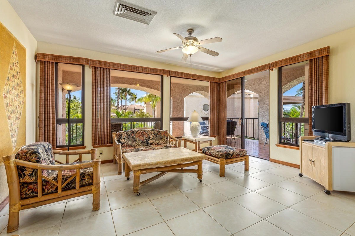 """GOLF COURSE AND OCEAN VIEWS FROM THIS REMODELED SECOND FLOOR 2 BEDROOM-2 BATH CONDO (#202) in sought-after Sandalwood Tower at the Shores of Waikoloa Beach. The Shores complex is well known for its unusually large and private lanais (498 sq. ft. in #202), perfect for relaxation and meals. The wrap-around window walls of the expansive great-room provide views extending from the Shores' interior koi ponds to the seashore. REMODELING IN 2013 included tile flooring throughout, top to bottom bathroom updates (solid granite counters, sinks, mirrors, lights, toilets, shower, tub), window coverings, refinished cabinets and doors, and repainting. New appliances include air conditioner (2015) tankless water heater, full-size washer/dryer, refrigerator, dishwasher (2018), and more. SHORT WALK to """"A"""" (Anaeho'omalu) Bay, Marriott and Hilton Waikoloa resorts, Kings Shops and Queens Marketplace, Roy's and Lava Lava restaurants. THIS BEAUTIFUL CONDO is being offered turnkey-furnished and is a licensed vacation rental. A must-see!"""