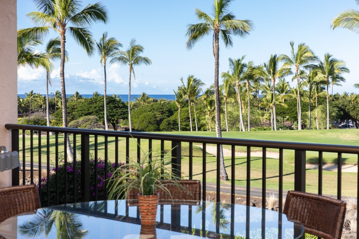 This special penthouse villa features ocean, golf course & Maui views from both bedroom suites, the living area and the 400+ square feet of covered lanai.  Towering 13' ceilings and an abundance of windows and glass doors fill the living area with natural light and tropical cross breezes.  Located off the living area, with updated appliances, granite counters, a pantry and a large window, the kitchen provides space to prep for parties or intimate dinners while keeping the cook involved in the festivities.  Each suite provides quiet luxury with direct access to the lanai and private bathrooms featuring updated tile, double vanities and glass showers plus separate tubs and water closets.  Parking provided by designated carport with additional parking throughout the neighborhood.  This villa comes fully furnished and has been meticulously cared for.  Recent updates include:- Paint throughout- New refrigerator- New washer/dryer- New plumbing fixtures- New lanai furniture- New beds- New TVsThe Shores at Waikoloa Beach Resort offers its residents a pool with spa, tennis courts, workout facility and grilling stations.  Located a short walk to everything the resort has to offer including restaurants, shopping, hotel amenities and the resort's beach at A-Bay.