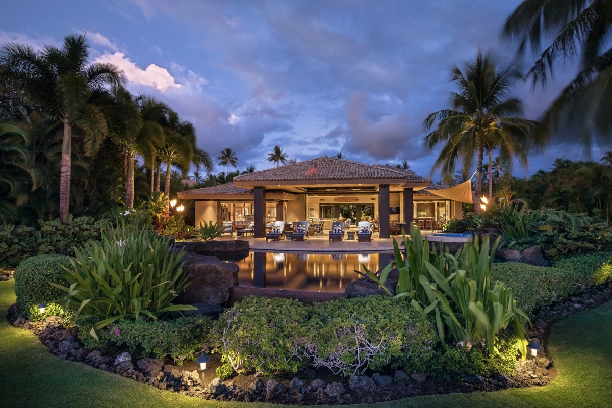 'Hale Aouli' enjoys an unparalleled location just yards from Mauna Lani Resort's pristine Pauoa Bay and the Fairmont Orchid Hotel.  This stunning, setback beachfront home designed by Lucky Bennett offers over 5,500 SF of indoor and outdoor living space with four bedrooms and 4.5 baths, on almost one full acre.  The home's lush grounds and interior courtyard with tranquil ponds lead to an airy open-concept great room that flows effortlessly out to a covered lanai, an infinity pool, and a roomy spa, with pano ocean views of the Pacific and the Island of Maui in the distance.  The residence features an elegant kitchen, luxurious bedroom suites with spa-like baths, indulgent shower gardens, and fine finishes such as stone floors, mahogany accents, French limestone counters, and exquisite furnishings.  Situated behind the gates of the exclusive Pauoa Beach Club and nestled between 2 hotels (the newly renovated Mauna Lani Auberge and Fairmont Orchid) this property extends access to incredible amenities and options of fine dining restaurants, grocery market, shopping and golf.  Established Rental Income.  Special Features include:• Custom built home, 4 bedroom, 4.5 Bath located in the best, private enclave in Mauna Lani Resort.• Gourmet kitchen with limestone countertops and curved, seated bar.• Generous outdoor lanai space offers bbq, dining and living areas and sunk in bar, perfect setting for entertaining.• Heated salt water pool with waterfalls and circular Jacuzzi.• Private Pauoa Beach Club amenities include: Gym, Lap pool, children's pool, private locker rooms, spa, sauna and steam rooms, massage pavilions, wine room, and entertainment pavilion exclusive only for Pauoa Beach homeowners.  • Steps from Pauoa Beach, homeowners have privileges to use the Fairmont Orchid Hotel amenities and restaurants.  • Enjoy all that Mauna Lani Resort can offer with Shopping, restaurants, golf and the ocean.