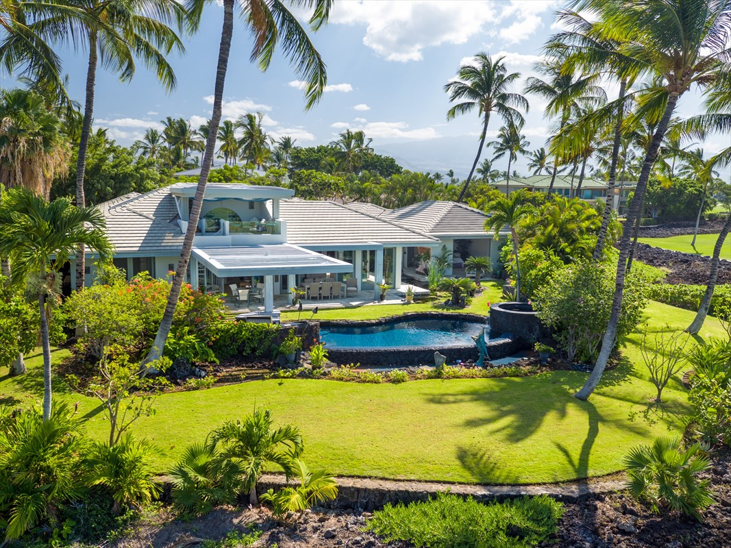 """BEST PRICED HOME ON THE ENTIRE KOHALA COAST!!! From the moment you step through the stained glass portal of this home designed by legendary architect Lucky Bennett, you'll be inside your own exclusive Big Island escape. With no neighbors in sight and the lowest HOA fees in the entire resort, this Mauna Lani Resort home is a rare and spectacular find featured by The New York Times as the perfect executive retreat and rightfully named """"Hale Maluhia"""" or """"House of Peace"""". Anything but ordinary and only a 5 minute walk from the Mauna Lani Beach Club and it's fantastic trails, this home is located in a prime area of the resort with breathtaking Hawaiian ambiance that will captivate you.Walk through the enchanting arched entry with intricate tropical art on the glass front doors and step inside to find your own gourmet kitchen and guest bedrooms, each with it's private bathroom, whirlpool tub, shower & air conditioning system. The spacious master bedroom contains it's own den. The adventure continues as you venture outside to hear and see the relaxing flow of your lava rock waterfall along with step over wrap-around Koi ponds, plus ocean and golf course views. Whether you plan to use the home to host exciting long-weekend retreats or make it a family home, the infinity heated solar pool, hot tub, wet bar's underwater seating and barbecue grill, are features that will allow you and your guests to create unforgettable memories to cherish for a lifetime. A one-of-a kind tropical Hawaiian escape."""