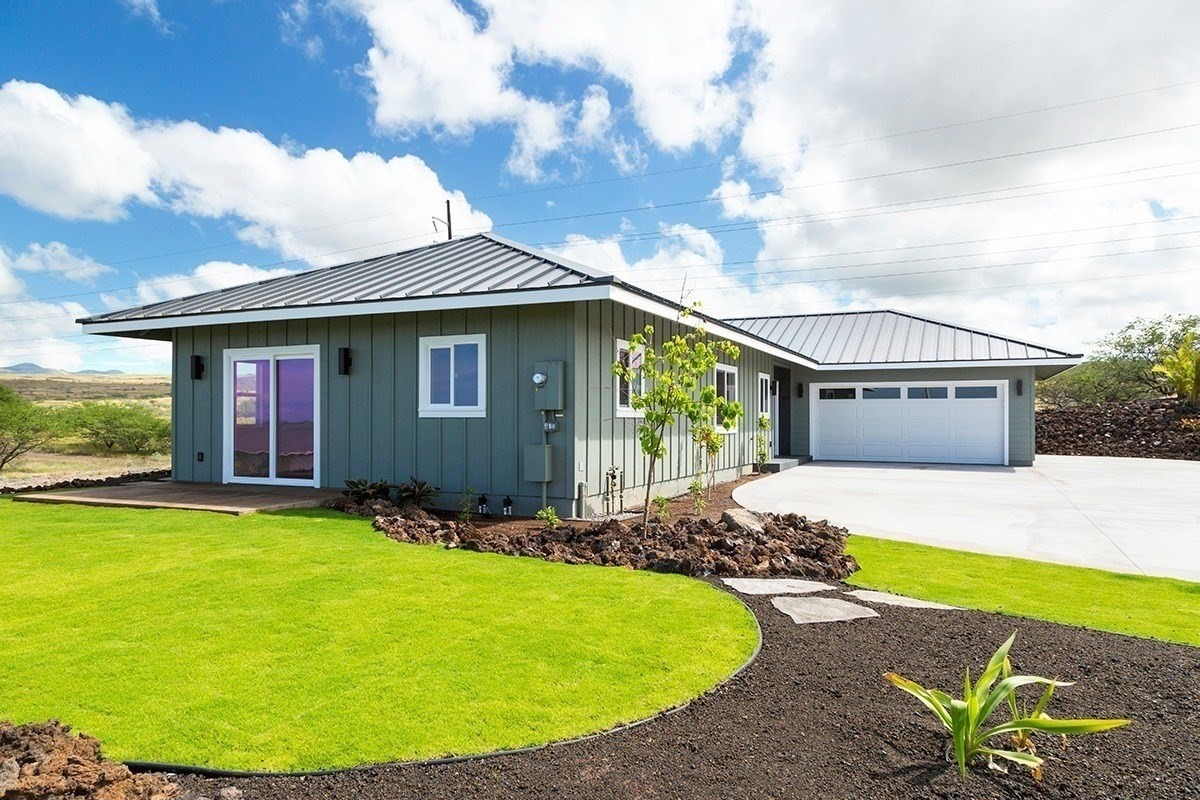 This newly constructed carefully thought-out, 3 bedroom/3.5 bathroom custom home with 1534 square feet of interior living space is built on a desirable corner lot on a private cul-de-sac. Enjoy stunning Ocean views in the front and Mauka views in the back. The home features:- 1534 Square feet of living space, 2400 square feet of total space including lanai and garage- Vaulted ceiling in the Kitchen, and Living Room- Acacia hardwood floors installed in every room of the house- Sliding glass doors- Tall 9 foot ceilings- Central air conditioning- Insulation in every interior and exterior wall, including the garage.- Gourmet kitchen with brand new stainless steel appliances, acrylic cabinets, farmhouse sink,- Acacia wood movable dining table, and Acacia top on the Island.- Covered lanai with tongue and groove wood ceiling- Recessed lighting throughout the home- Spacious walk-in closet in master bedroom- Rain Shower-head and jacuzzi bathtub in master bath as well as 2 sinks with backlit LED lighted mirrors- Each bedroom has an en-suite bathroom- 2 car garage with epoxy flooring which connects to a spacious and one-of-a-kind 1500 sq foot paved driveway- Fully irrigated and low maintenance artfully designed landscape which includes grass, fruit trees, and stepping-stones around the house- Waikoloa Village members enjoy a community pool, tennis courts, golf course, restaurants, and many other conveniences.- Tiled front entrance featuring steel door with sidelights - LED lighting around the exterior of the house- Holiday and Camera outlets outside below the roof line- Screw-less electrical plates- Designer tile, floors, toilets, vanities, hardware and lights throughout the house- Amazing breeze when the sliding doors are openEvery single aspect of this house is well thought about. All the way to the last nail.