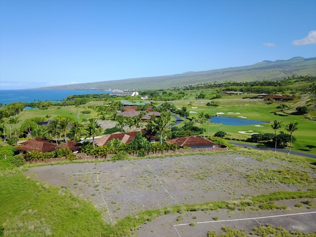 Offering one of the best priced building site within the private gated community of Kauna'oa at Mauna Kea. This home-site overlooks the private par 3 golf course exclusive to Kauna'oa homeowners as well as the 13th fairway of the Mauna Kea golf course. With stunning views of the Kohala Mountain range, the level graded lot has a building envelope area of approximately 29,827 square feet.Owner has obtained preliminary review for a custom 5 bedroom 5 1/2 bathroom home. Special features include a fitness room, a large private yard with swimming pool, spa, cabana sundeck, and an auto court at the home's entry with a large 2 car garage . House plans by architect Stephen Grant Green are included.  SGA designs reflect the highest degree of creativity, eloquence and invention combined with a sense of pragmatism and lifestyle utilization. Please ask listing agents for plans and concept package. In addition to the Mauna Kea Club opportunities, this lot enjoys the benefits of the Kauna'oa private club facility with a private fitness center, pool, spa, meeting room, concierge services and a private Weiskopf designed Par 3 practice course directly across the street.  This unique opportunity allows owners to have the luxury of walking to Mauna Kea Beach or Hapuna Beach, two of the finest white sand beaches in Hawaii in addition to golf cart access privileges to the Kauna'oa Bay and the Mauna Kea Golf Clubhouse.