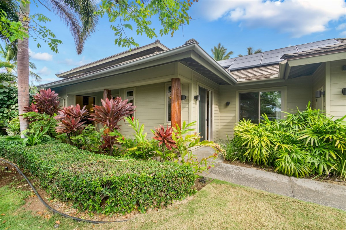 Presenting luxury living at its finest, Ka Milo is often described as a resort within a resort and combines beautiful open spaces, outdoor living, awe-inspiring landscapes, and a true sense of community to give its residents a luxurious resort lifestyle. Unit 216, known as the Honua plan B, stands above the rest with two master suites and two additional bedrooms, each with access to an outside courtyard sitting area.  Sold turnkey furnished, this four bedroom, three and a half bath home can make an exceptional vacation rental with it's flexible floor plan or an ultimate getaway with plenty of room for guests and family. The upstairs master suite boasts views of Mauna Kea and Kohala Mountains from its private lanai, and a luxurious bathroom appointed with a large soaking tub, walk in shower, dual vanity sinks, and a walk-in closet. The downstairs master suite mirrors the upstairs with the added benefit of enjoying the greenspace behind the unit.  A short walk along the green leads you to the world-class recreation center that is the largest amenity of its kind in the area, complete with gathering hale, fitness center, sand beach family pool, two jacuzzis,  and an adult lap pool.  They say that the kitchen is the heart of the home, right? Appointed with Thermador appliances, a wine fridge, and generous granite countertops, this rings true in this home. Enjoy meals inside or on the covered lanai. Outfitted with a complete wet bar and Wolf barbeque, it is a great place to gather. Approximately 677 square feet of covered and lanai and more than 2100 square feet of living space. Central air conditioning keeps things cool and a complete photovoltaic-solar electric system helps to maintain low utility costs. HOA Fees include water, sewer, trash removal, exterior pest control, basic cable, pool & recreation area maintenance, and landscaping. Walking & biking trails from KaMilo lead to shops, dining, white sand beaches, and more.