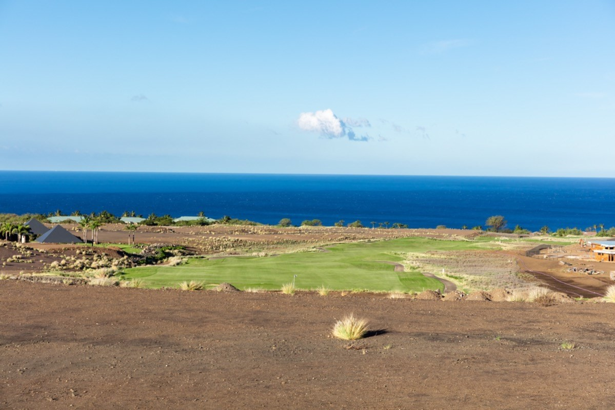 """It is no accident that Rockefeller chose this very place to realize his vision. As he surveyed the length of the coast he selected the two most perfect beaches, but also the land with the most character. He recognized the opportunity to create golf courses with character, and homesites with expansive views and a benign climate that were all unique to what would become Mauna Kea Resort.Indeed, those that know Hawaii, and especially those fortunate to live here full time often favor mauka properties – those on the mountain. Breezes tend to keep the temperatures a bit cooler, but elevation also rewards owners with spectacular views – panoramic 360° vistas from the snow-capped Mauna Kea to Hualalai, and 50-miles of white water shoreline that run the length of the Kohala Coast. In the distance, neighboring Maui and Haleakala.The second release of Hapuna Estates are 10 homesites measuring from more than one half to over one acre. They sit privately above the 8th fairways of Arnold Palmer-designed Hapuna Golf Course. Owners may choose to join the Club at Mauna Kea Resort and enjoy both the Hapuna and Mauna Kea golf courses, along with all the renowned amenities of two of the best luxury hotels on the island. Estate owners can also walk to the Amaui Clubhouse, designed by de Reus Architects, one of Architectural Digest's """"Top 100 Architects and Designers."""""""