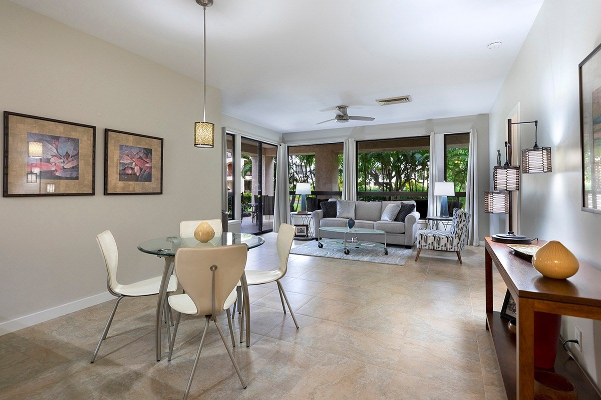 Located in The Shores at Waikoloa with its stunning koi ponds, oversize lanais and unparalleled outdoor spaces, this stunning  ground floor 2bd/2bth 1118 sq ft unit has been completely renovated with an attention to detail guaranteed to impress the most discerning buyer.Ceramic tile flooring throughout, including the lanai, creates a seamless flow from living room to kitchen and bedrooms and helps highlight the kitchen's beautiful maple soft-close cabinetry, granite counter tops/backsplash, stainless steel appliances and stylish bar seating.The master bedroom features canister lighting, his/her closets and an impressive en suite bath with bamboo cabinets, limestone countertop, free-standing modern tub and large walk-in shower with limestone walls and bench.  The skillfully redesigned spacious 2nd bedroom created a separate laundry room, more closet space and a beautiful en suite bath with vessel sink and walk-in shower.  Beautiful areca palms and hibiscus surround the unit's large 498 sq. ft. wrap- around lanai providing a sense of privacy in a tropical paradise. The Shores at Waikoloa's ground floor units have lower maintenance fees than top floor units. One dedicated parking space comes with the unit and there are ample visitor/guest parking spaces.This unit has been a private residence for the past 6+ years and was not in a rental pool although The Shores at Waikoloa does allow vacation rentals.Furnishings are negotiable.Listing agent is the owner