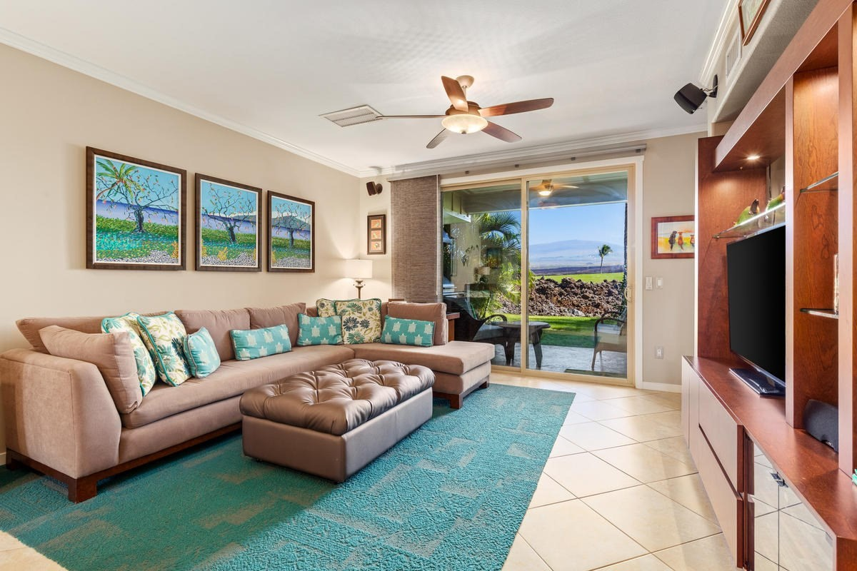 This wonderful Golf Villas ground floor condo has been upgraded from top to bottom by the original owner who has been running a successful vacation rental. Continue to vacation rent (the unit is registered), or move in and enjoy all that this condo offers yourself! As you step through the front door you can't help but notice the view across the golf course to Mauna Kea right out the lanai slider doors! There is a comfortable elegance here from the crown moulding to the tile floors. Designer paint colors add personality to each room and the modern furnishings and decor have a subtle island flair. No surface has been untouched from the quartz countertops in the bathrooms and kitchen, to the glass tile backsplash, updated faucets, and lighting throughout~ this place has it all and is being offered turnkey furnished! The lanai with the big Mauna Kea view is tiled and has a clean, well maintained bbq area with gas grill. This is the perfect place to sit and enjoy the fresh island air while the kids play in the grassy area right outside. The master suite boasts lovely views, a dual-sink vanity, and walk-in closet. The appliance package is all stainless steel with the exception of the, new in 2019, stackable washer/dryer unit (white). And, there is a one-car garage with TWO tandem parking spaces in front. Truly, all you need is your suitcase and toothbrush to be comfortable here, as the home has everything you need to move right in and the garage houses everything you need for outdoor fun. The Golf Villas have undergone recent renovations. Exteriors in the entire project were repainted, signage replaced, roadways resurfaced, landscaping upgrades made, mahogany doors added, garage doors replaced, pool/pool decking resurfaced, and pool furniture replaced. Owners in the Mauna Lani Resort enjoy access to the Mauna Lani Beach Club and the various amenities within the resort. Don't miss your opportunity to own this wonderful condo in the famed Mauna Lani Resort.