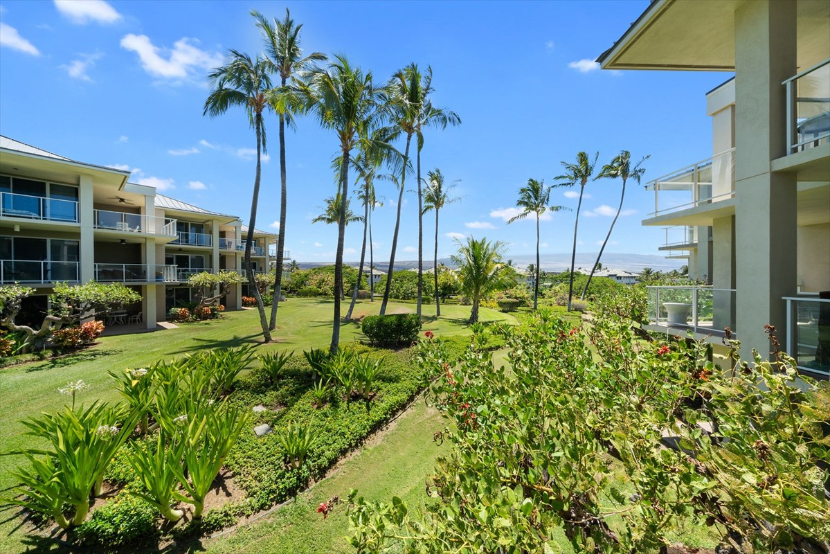 Updated unit with high end finishings and wrap around lanais make this two bedroom unit in Vista Waikoloa hard to beat! Gorgeous details in this gourmet kitchen with granite countertops, stainless appliances and open concept into the dining area and with an eat in bar. The dining room leads into an oversized living space with two walls of sliding glass doors that open onto large wrap around lanais with gorgeous, tropical mountain views and warm breezes. Side lanai leads into the huge master bedroom with en suite master bath. Double vanities, granite counters and shower and lots of space and light. Down the hallway and across from the dining room are slide away doors that hide a guest bedroom. Side door leads to hallway with laundry closet and guest bathroom with same granite finishings. Unit includes one dedicated parking stall and 35 additional visitor spaces. Your fully furnished, turn key, bright, open, tropical and comfortable slice of paradise is ideal for year round living, home away from home or vacation rental. Vista Waikoloa's gated community, located just 20 minutes from Kona International Airport, with 122 units in just 7 buildings, hosts many amenities including bike racks, elevators, shared storage closet, heated saltwater pool, private fitness room with 24 hour access, covered pavilion, 6 BBQ Gas Grills, mail delivery and a 24-hour business center with wi-fi, computer/printer/fax/shredder access.Visit www.vistawaikoloahoa.org for more information.