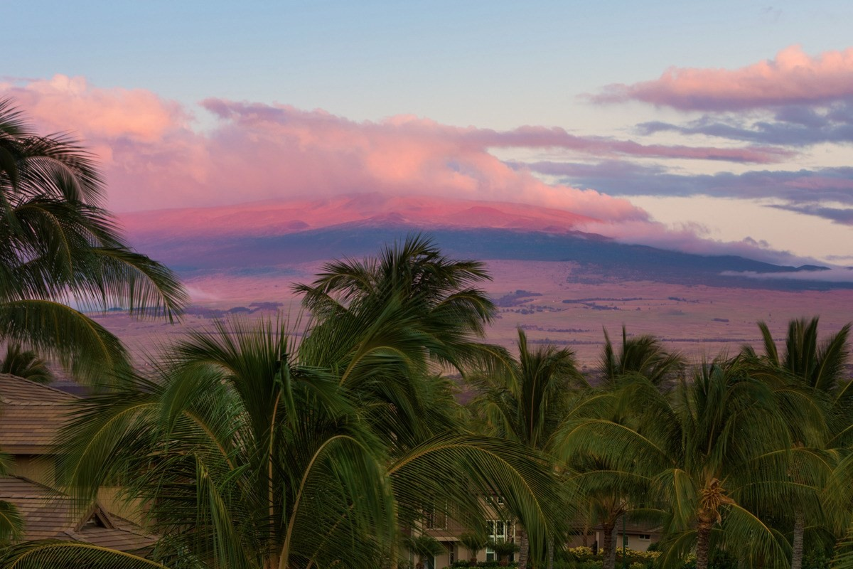 """First time on the market for this never rented, outstanding Hali'i Kai 3 bedroom, three bath townhouse with views to the Coconut Grove common area.  See Matterport Video in link above. This home is sold fully furnished and features excellent views of Mauna Kea, Kohala mountains, as well as a """"peek a boo"""" view of the ocean, all from the upper lanai, which is adjacent to the Master Bedroom suite. At 1677 sf, this unit is the largest floor plan within the development, with plenty of room for guests.  The kitchen includes granite countertops, African Mahogany cabinets, stainless steel appliances, and central air. Completing the package is a one-car garage with an additional parking space directly in front of the garage. The main floor features an open kitchen, living and dining space, and a generous lanai.  Luxury features continue on the lower level with a full laundry room, which includes a full-sized washer and dryer, two huge storage closets, and a bedroom and full bath. The upper level features the master bedroom with a private lanai and en suite master bathroom with a walk-in shower and soaking tub. There is also a second bedroom and bath upstairs with great views of the Hualalai Volcano.  Furnishings included with an acceptable offer so you can move right in and enjoy the resort lifestyle!  Halii Kai is located in the Waikoloa Beach Resort, which is well known for its low-density well-designed community and oceanfront amenity center.  Situated on approximately 29 acres- Hali'i Kai has an atmosphere of a private residential neighborhood.   Halii Kai oceanfront amenities include a lagoon-style pool, sand-bottom hot tub, fitness hale, and intimate restaurant with a full bar. The ocean club is the perfect spot to watch whale antics November through April and gorgeous sunsets year-round. There is also a tennis and a half-court basketball court.  Waikoloa Beach Resort amenities include the beach at Anaehoomalu Bay, two golf courses, two hotels, and two shopping centers"""