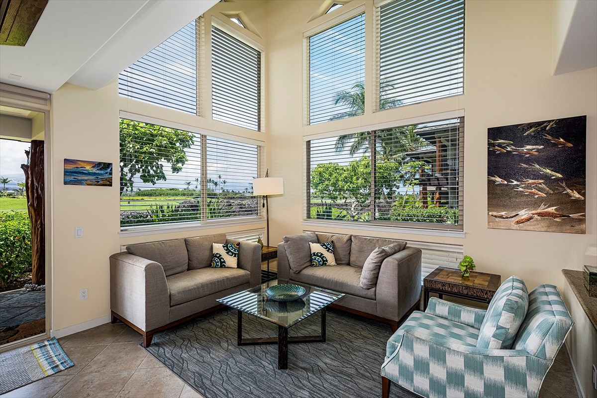 Golf Villas O4 at Mauna Lani Resort - Premium Corner Condo 2-story windows in living room with bright open feelUnobstructed golf and mountain viewsLarge 3 bedroom, 3 bathroom with loftWell appointed fully furnished- Two-story living room- Vaulted ceilings in great room- Gourmet kitchen with breakfast bar - Granite counters throughout - Tile Flooring- Additional deeded parking in front of the unit- Fully furnished with upscale furniture- Established Vacation Rental Property with STVR CertificateGolf Villas is a quiet private gated luxury condo community with pool, spa, fitness room, and BBQ area. Mauna Lani Advantage Club Membership is offered to all Mauna Lani property owners with access to private beach club.  Mauna Lani Resort world class rest destination has sandy beaches, private beach club, two championship Golf courses and the Shops at Mana Lani. Mauna Lani has magnificent grounds restaurant ocean sports, 27 acre historic park with fish ponds, walking trails and amenities include lap pool, tennis, spa and fitness center.   Mauna Lani has two 5-star anchor hotels: The Augerge Resort Collection  and The Fairmont Orchid.  Stunning ocean front dining and fine restaurants including  Ruth's Chris Steakhouse and Tommy Bahama all just minutes away. Enjoy luxury resort living at it's finest!