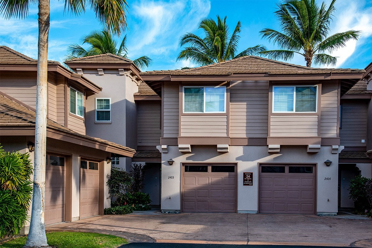 Colony Villas #2403 at Waikoloa  Beach Resort is a remarkably well maintained, turnkey furnished, 2 bedroom 2 1/2 bath townhome with an attached garage. The interior is a very spacious 1446 sq ft, with 18 ft ceilings, and no one living above or below you. Relax and enjoy the quiet and peaceful surroundings on either of the two covered lanais, overlooking the Kohala mountains, with peekaboo ocean and Maui views. The open concept downstairs offers a galley kitchen with granite countertops, refinished cabinetry, as well as a new refrigerator and microwave. A few other features include recently installed porcelain tile flooring, new living room furniture and the entire unit has been painted with an aesthetically pleasing palette over the last couple of years. In addition, there is a conveniently located 1/2 bath and a useful storage area that can double as a pantry if needed. When you aren't using the A/C, a retractable screen front door allows cool breezes through the unit. Upstairs has newly installed Berber carpet in both bedrooms and a brand new stackable washer/dryer. The en-suite bathroom incorporates a separate shower stall, tub, double sinks, and ample closet space. Whether you're looking for a full time home, a second home, or an investment, this is a perfect choice. Zoning allows for short term vacation rentals, if so desired.Waikoloa Colony Villas is a private, tropically landscaped, gated community that includes 2 swimming pools, hot tub, tennis court, fitness center, and BBQ area. In addition the maintenance fees include water, rubbish service, sewer, cable, internet, master insurance, and quarterly exterior and interior pest control.Waikoloa Beach Resort is located on the Kohala Coast, strategically situated near shopping, restaurants, and 2 world class golf courses. Within walking distance or just a short drive, are some of the Big Island's best beaches. All combining to make this an unparalleled destination to call your next home.