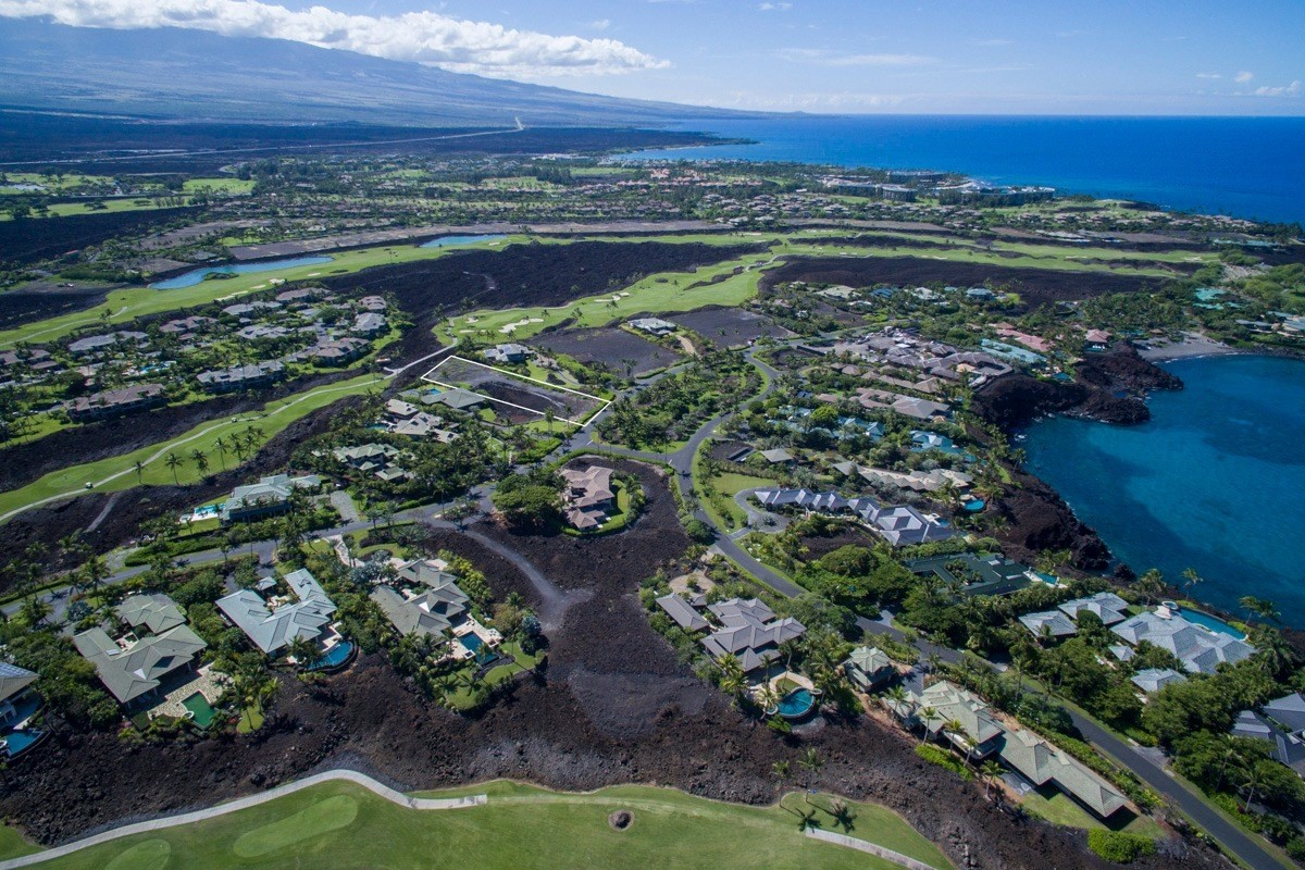 This beautiful, golf course frontage lot is ready for a new home. Graded and level building area offers views across the 10th hole of the Mauna Lani South Course and on to, sometimes majestic snow-capped, Mauna Kea and Mauna Loa. 49 Black Sand Beach is a private, gated development of golf course and oceanfront lots with access to a beautiful, secluded pristine black sand beach and owner amenities which includes an oceanfront pool, gym, tennis courts, full-time concierge, and a large celebration area. As a homeowner at 49 Black Sand Beach, you also are offered membership in the Mauna Lani Advantage Club, which affords access to a gorgeous white sand beach, oceanfront fine dining at Napua Restaurant, and discounted tee times at two world-class golf courses.
