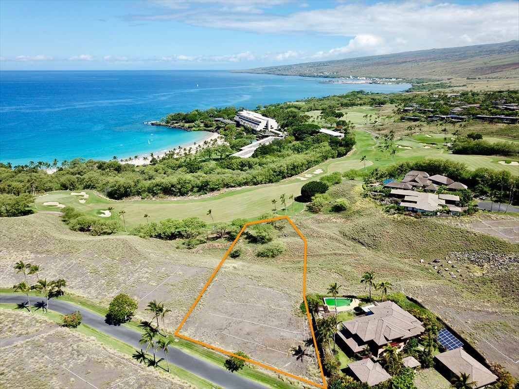 One of the best building sites within the private Kauna'oa Community. This perimeter home-site overlooks the 10th fairway and green of the Mauna Kea Golf Course and offers unobstructed ocean views. You can hear waves breaking on the beach fronting the Mauna Kea Beach Hotel, which is within an easy walk. The level graded lot has a building envelope area of approximately 18,116 square feet.Owner has obtained preliminary design approval for a custom 5 bed. 5 1/2 bath home which includes a private upstairs master bedroom suite and fitness room. Special features include a media room, a large private yard and garden area with swimming pool and spa overlooking the 10th fairway and beautiful ocean views.  House plans and renderings by architect Stephen Grant Green are included. See photos for more details on the home. SGA designs reflect the highest degree of creativity, eloquence and invention combined with a sense of pragmatism and lifestyle utilization. In addition to the Mauna Kea Club opportunities, owners at Kauna'oa enjoy the benefits of the Kauna'oa private club facility including a fitness center, pool, spa, meeting room, concierge services and a private Weiskopf designed Par 3 practice course directly across the street. This unique opportunity allows owners to have the luxury of walking to Mauna Kea Beach or Hapuna Beach, two of the finest white sand beaches in Hawaii in addition to golf cart access privileges to the Kauna'oa Bay and the Mauna Kea Golf Clubhouse.