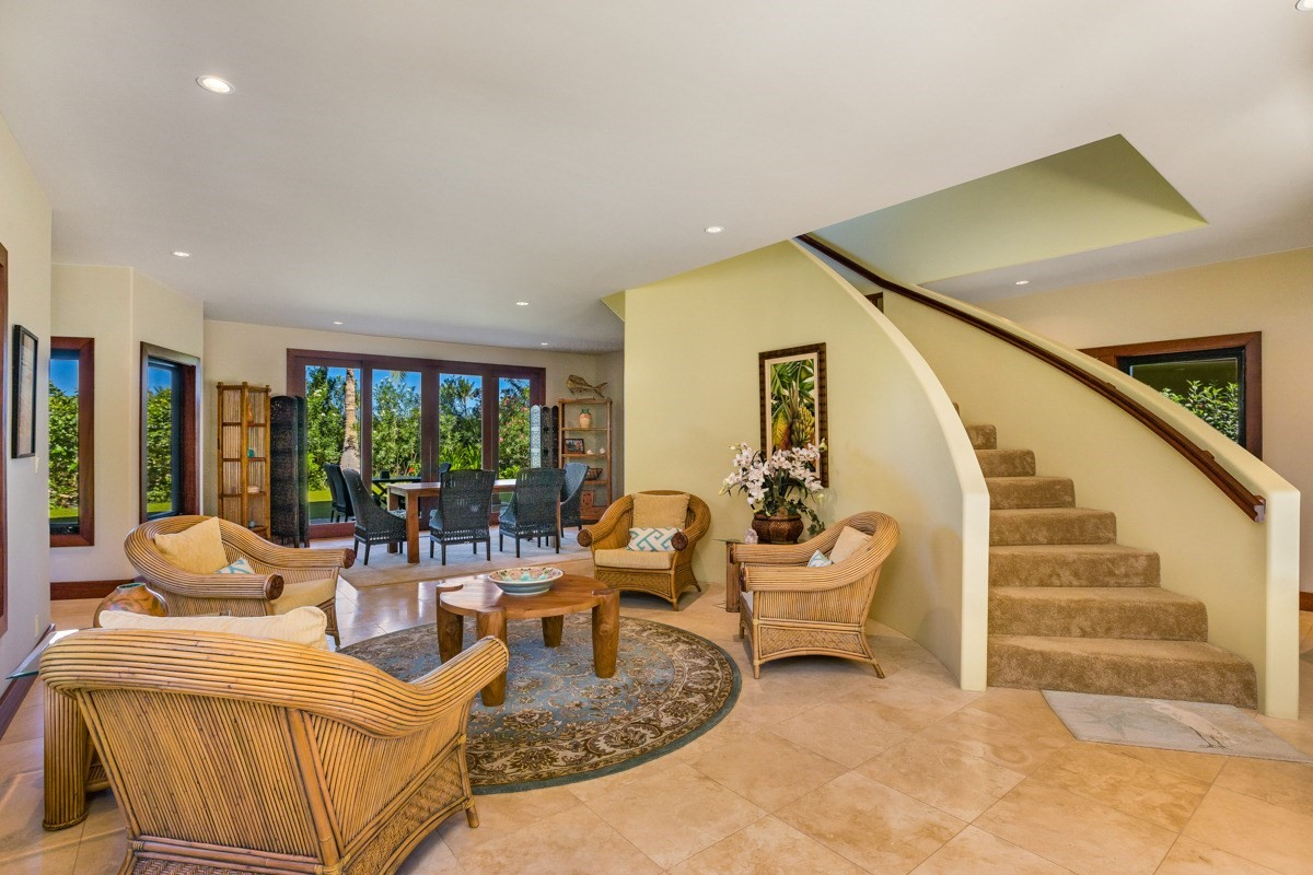 A truly unique opportunity to purchase a quality home in the prestigious community of 49 Black Sand Beach. Known for it's ultra private and secure nature and it's breathtaking oceanfront Amenity Center, 49 Black Sand Beach is second to none in the historic Mauna Lani Resort.This two story four bedroom, five and a half bath home with just under 4,900 square feet of living area is situated on a large lot of over an acre in size with ample space to add a pool and spa area. Lot #32 is an oasis of lushly landscaped garden areas with many mature trees which provide a cool shaded environment.Used as a primary residence since 2013, the home shows impeccable care and maintenance with attention to every detail. From the large gourmet kitchen to it's multiple entertaining and lounge areas and oversized bedrooms and bathrooms, this home has it all.Owners within 49 Black Sand Beach enjoy the benefits of the oceanfront Amenity Center complete with it's workout pavilion, tennis court, lap pool, entertaining and poolside lounge areas areas with a full kitchen and full time concierge services. All situated on a gorgeous black sand beach with stunning crystal clear waters with world class snorkeling paddling, etc.