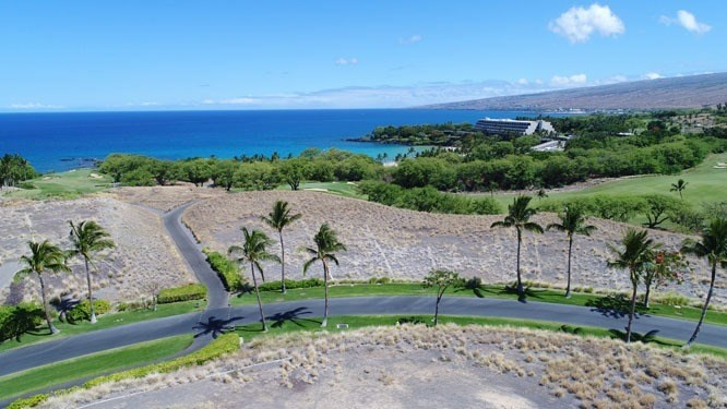 Located within the gated community of Kauna'oa, consolidated Lots #7 and #8 (now lot 7) offer over 100,000 square feet of land and over 55,000 square feet of building area with panoramic ocean and sunset views. A very unique setting within an approximately 700 foot walk to the beach at Mauna Kea. Perched above the of hole #10 on the Mauna Kea Golf Course, allowing for breathtaking golf course views, and as one of just 26 exclusive custom home-sites, the property affords privacy yet accessibility to every amenity possible at the Mauna Kea Beach resort as well as Kauna'oa's own private club. Club privileges include use of the spa and exercise facilities, a private Par 3 Practice Course created by Weiskopf Designs, an infinity pool and spa, clubhouse and concierge service. Perfect for a family compound or a home with private grounds.