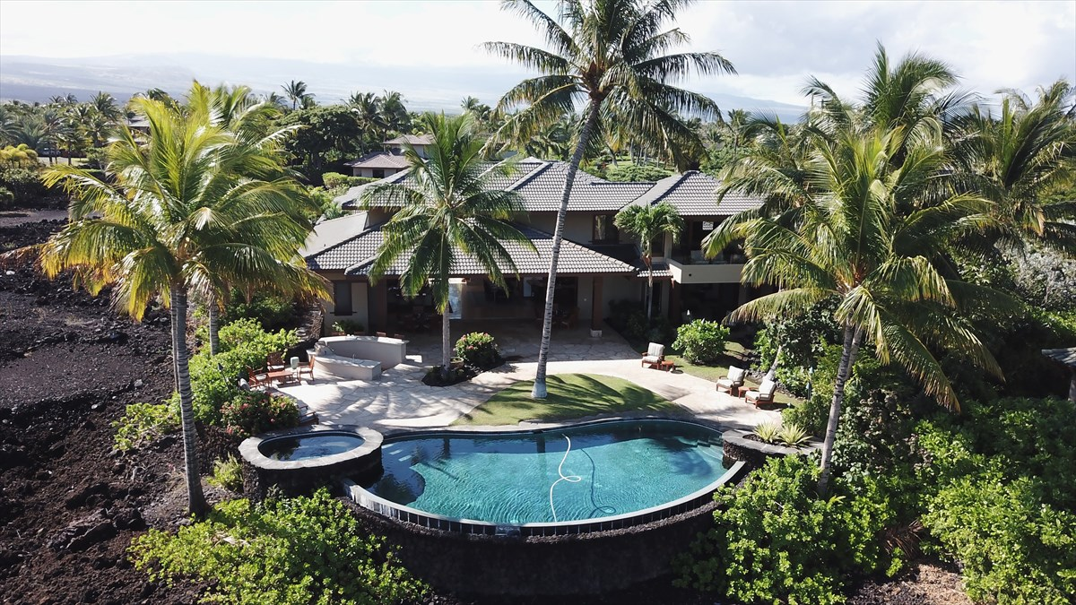 Need space? Almost an acre? Multigenerational family living!  Need the ocean?  Need golf?  Need a private office?  Need a homeschooling room?  Need several separate and private master suites?  Need a private beachfront club with a fitness center?  It's all here! Mauna Lani Resorts best!  An exclusive gate-guarded community of 49 Black Sands Beach.  Over 5,000 sq ft of quality construction.  5 or 6 bedrooms, 5.5 baths.  Mesmerizingly stunning ocean and golf views.  Nothing between you and the ocean except golf greens!  The home design was based around family entertaining with its voluminous great room overlooking the pool and spa and massive outdoor entertaining area.  This community has it's own private oceanfront beach club!  The Beach Club hosts a fitness center, oceanfront pool, and spa, covered lounges, and an entertaining pavilion. Be sure to click on the 3D virtual tour and see every detail!