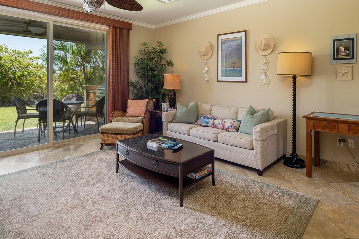 Beautifully maintained, ground floor, condominium along the 10th fairway of the Francis H. I'i Brown South Golf Course. This 2-bedroom, 2-bathroom, turn-key, and fully furnished condo is ready for you to enjoy as your primary residence or as a Short Term Vacation rental. The current owner has an active STVR license that can be transferred to the new buyer upon approval of your application.Copy and paste this Matterport link into your browser and take a Virtual Tour!https://my.matterport.com/show/?m=eEU8dRENTd2&mls=1Key features:*Upgraded natural stone floors. The natural stonework continues along the baseboards and includes the shower and tub surround. Carpeting in both bedrooms.* BBQ grill and granite prep area, located on your private lanai*Both bedrooms have grass-cloth ceiling accents*Sofa Bed couch for extra guests*Newer refrigerator - 2019, with ice-maker*Newer stackable full-size Washer and Dryer 2019*TV's in each bedroom* Single car, detached garage*Assortment of beach gear in the garageThe Golf Villas on-site amenities include a resort-style lagoon pool, spa, barbecue area, and fitness center. Homeowners, are eligible to join the  Advantage Program. This gives you private beach club access, reduced rates at two championship golf courses, and other discounts