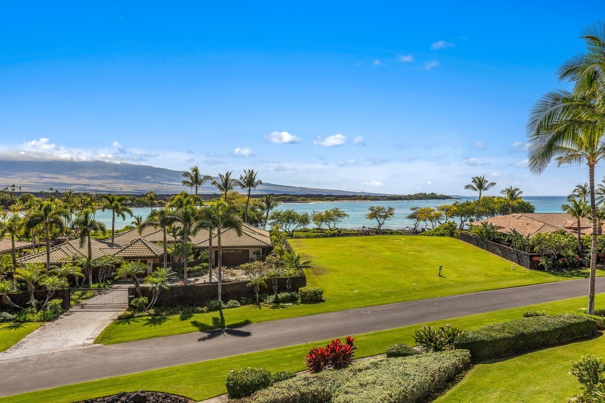 """Tour this tour to """"walk thru"""" this deluxe Hawaiian Penthouse! https://my.matterport.com/show/?m=Nx3xSVbuPEe&brand=0~Enter this safe & clean environment via an exclusive-use elevator to find KOLEA 7F; that elusive quest for the perfect single level residence with crystal blue ocean views, indoor/outdoor living, & direct access to the beach! This front row Villas is ideal as primary residences or vacation rentals! Priced to sell @ less than recent comparable.~Your first impression will be luxury & privacy! An exclusive-use elevator leads to a private foyer on the top floor. Next; enter to find unobstructed ocean, mountain & coastline views. The brilliance continues thru fully-retractable pocket doors to an expansive lanai & summer kitchen. Experience the ultimate in indoor/outdoor living; a cool drink, stunning sunsets, star-gazing, soothing sounds of the ocean… or?~The 3 bed, 3.5 bath, 2147 SF home is GRAND! Soaring ceilings, clerestory windows +skylights. The Great room/kitchen is perfect for entertaining w/ ocean view, central island, granite, Viking/Sub-zero stainless appliances, wine cooler, ample cabinetry, light & windows. All 3 bedrooms are en-suite w travertine floors, surrounds & back splash in the baths. Master & Jr. Master offer dual vanities, private commode, soaking tub & over-sized walk-in showers, (no threshold). Quality craftsmanship & appointments throughout; high ceilings, mahogany wood, cabinetry, pendant/custom lighting, ceiling fans +more. Full laundry/utility room & garage offer """"single family convenience"""" without the hassle.~You may never leave """"HALE KAHAKAI"""" Amenity Ctr; a mini-resort w/infinity pool, spa, sand-bottom pool, pavilion/kitchen & Fitness. Or reserve """"guest hales"""" for overflow guests, (small fee). KOLEA is the only WAIKOLOA BEACH RESORT community w/direct access to ANAE'HO'OMALU BAY & BEACH. Explore, relax, play or stroll to LAVA LAVA BEACH CLUB! Walking distance to world class hotels, dining, shops, golf & more!"""