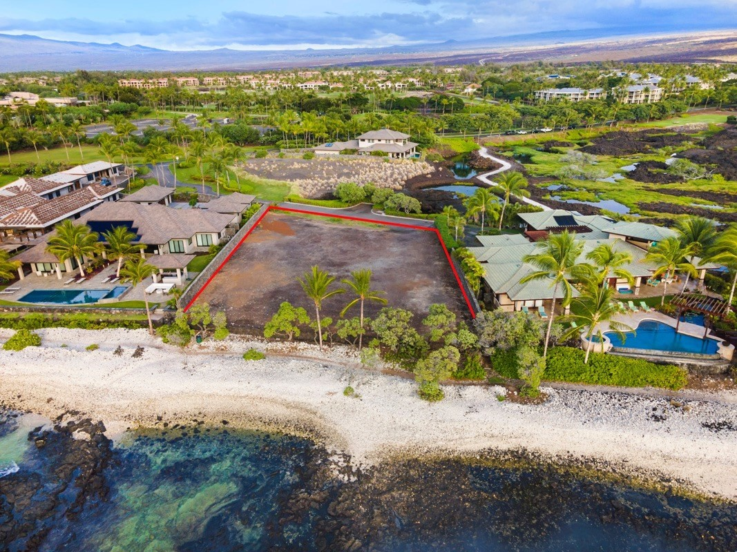 Looking to build your dream home on a truly oceanfront Lot within a Resort on the Kohala Coast of the Big Island of Hawaii? Look no further than this property, located within the gated and exclusive enclave of Naupaka Place. Naupaka Place is nestled between the Waikoloa Hilton and beautiful Anaeho'omalu Bay, both of which are within easy walking distance along the coastline. There are only 15 Lots within the Resort that are oceanfront with direct access to the ocean. That's all there will ever be. Like to surf? There's a nice little break you can paddle out to by walking down the few steps from your home to the ocean. Enjoy sunsets? You will have them 365 days a year from your pool deck. Like to watch the sunrise? Open your front door and watch the sun come up over the Mauna Kea volcano, which is often snow-capped during the winter months. Sound like a nice way to spend a typical day in a home you have built just the way you want it? Here's your opportunity. Lot 4 is nearly an acre in size at 41,269 SF, all of it usable. You can build either a single level or a two-story home on the property. The Lot is ready to build, with all utilities to the property line, and rock walls already built by the owners of the estate homes on either side. The building envelope is a generous 19,954 SF. The property has 130 lineal feet of ocean frontage. The location of the Lot within Naupaka Place is ideal. It is far enough away to not notice the hustle & bustle of the Hilton and is sheltered from the beach access path by the house next door.Enjoy the convenience of living in the Waikoloa Beach Resort. The Resort offers world-class golf, shopping, and dining. Entertainment venues include an outdoor amphitheater for concerts and a luxury movie theater. Build your dream today!
