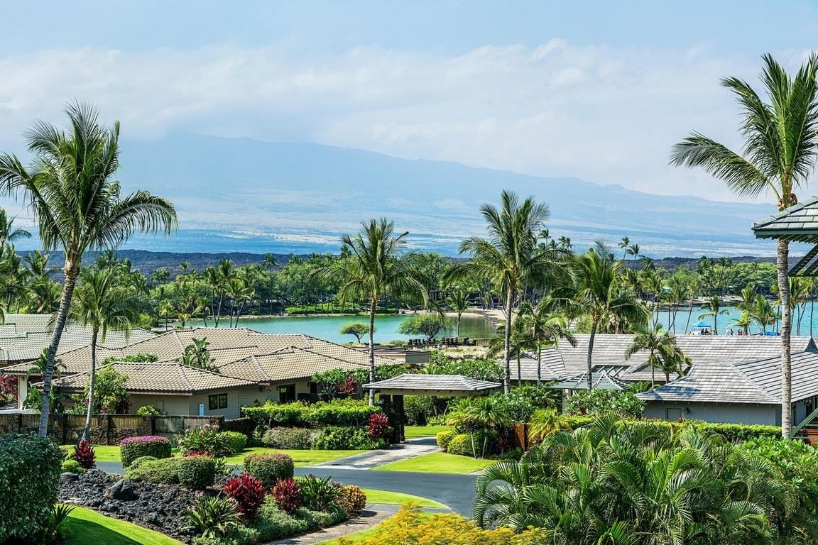 Stunning views of Mauna Kea, Hualalai, the Ponds, the blue Pacific and Kolea's lush gardens greet you at Kolea 11C, a luxurious 1,554 sq. ft., end penthouse unit in the heart of the beloved Kolea community within Waikoloa Beach Resort. Wake up to sunlight and birdsong. Enjoy your morning coffee on the lanai caressed by the gentle breeze. This is where you want to be!High end finishes include African Mahogany trim, granite counter tops, Travertine flooring, 9 foot retractable pocket doors, and an outdoor kitchen. The two master suites allow privacy and comfort for owners and their guests. The unit is steps away from the elevator for easy entry. Family friendly Kolea offers direct beach access, an infinity pool, a sandy bottom kids' pool with waterfall, workout facility, and hot tub. Guest Hales located near the pool offer an additional amenity to owners in need of extra space for family and friends. This lovingly cared for home is being sold furnished and has an excellent rental history with many loyal, repeat guests. Hawaii Island is one of the most remote places on the planet, and also one of the most beautiful. Take your pick of beautiful beaches nearby, hike a picturesque trail along Akaka Falls, and stargaze on Mauna Kea. From deep sea fishing to reef snorkeling, the ocean activities are endless. Unit 11C offers easy 5 minute walking distance to sand and surf, as well as the resort's pools. Right across the street from Kolea's front gate are the King's Shops with upscale boutiques and restaurants. A short walk away is the Queen's Marketplace with its gourmet grocery, shops, dining, and entertainment. A luxury movie theater is now open where you can sip wine or order food while watching the latest flicks. Waikoloa Beach Resort has two golf courses, as well as the amenities of two adjacent hotels with their restaurants.Kolea 11C is ready for a new owner to enjoy as a wonderful home or investment.