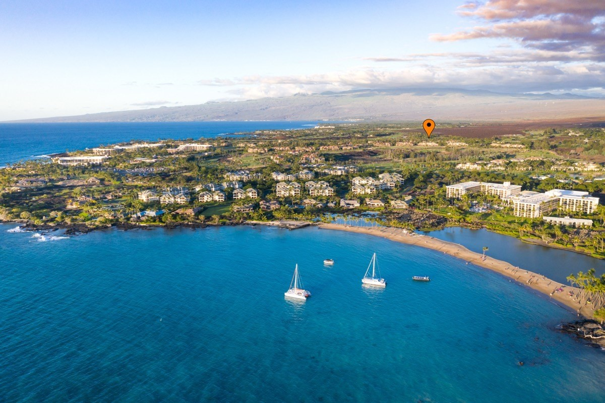 This very private, very spacious 3BR/2.5BA, 1,699 sf townhouse located in the very popular Waikoloa Beach Resort near a famous white sand beach has been remodeled and looks amazing!Virtual tours can be seen here:https://leecaptures.wistia.com/medias/zu4xhxbnb9#https://my.matterport.com/show/?m=3AJv9ThScy1&mls=1&play=1&ts=1&hl=0Some of the more notable features of this amazing condo include:* Stunning, open floor plan* Very private setting within the resort complex* Gorgeous golf course frontage* Amenities include two swimming pools, two fitness rooms, health club, spa, BBQ area and tennis courts* Soaring 17' high ceilings and tons of large windows for a lot of natural light in the great room!* New luxury wood-like vinyl flooring on the lower level* Fresh interior paint* Exceptionally well-maintained and move-in ready* Your kitchen features a solid granite countertop with breakfast bar seating as well as a large dining area* Solid travertine countertop in master bath* Your master bath also boasts a dual vanity, walk-in shower and separate soaking tub* Central air conditioning throughout to keep you cool and comfortable after a day in the sun* Includes high-end tropical furnishings and artwork* Enjoy a cup of famous Kona coffee on the private lanai off the master bedroom* One-car garage with remote* Gated community* Very close to the famous, highly coveted white sandy Anaehoomalu Bay!  Roll out of bed and into the azure Pacific Ocean for some fun in the sun anytime you like.Maintenance fees include:  Insurance on the building itself, cable TV, internet, water consumption, landscape maintenance, sewer, trash removal, quarterly interior and exterior pest control, swimming pool maintenance, grounds maintenance and private gated entry. The Resort offers two shopping centers, a luxury movie theatre, several restaurants and access to famed Anaehoomalu Bay for fun in the sun!
